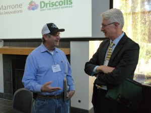 Brian Leahy (left) speaking with Malcolm Ricci, of Bolthouse Farms of Bakersfield.
